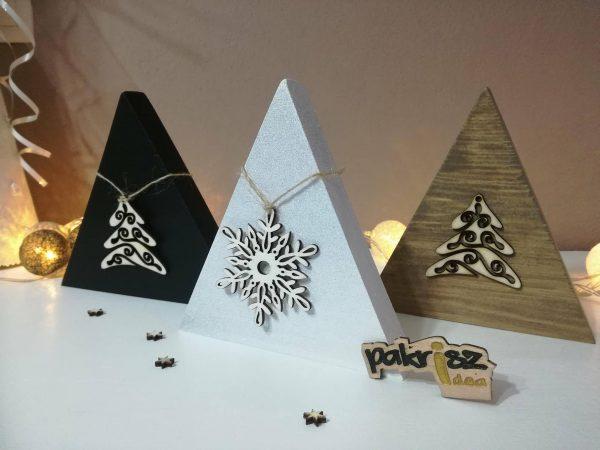 Dekorácia s vianočnou ozdobou. Biela, čierna a hnedá - staré drevo
